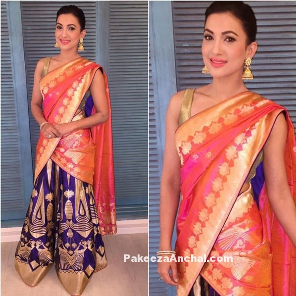 Gauhar Khan in a traditional Half Saree in Orange and Purple