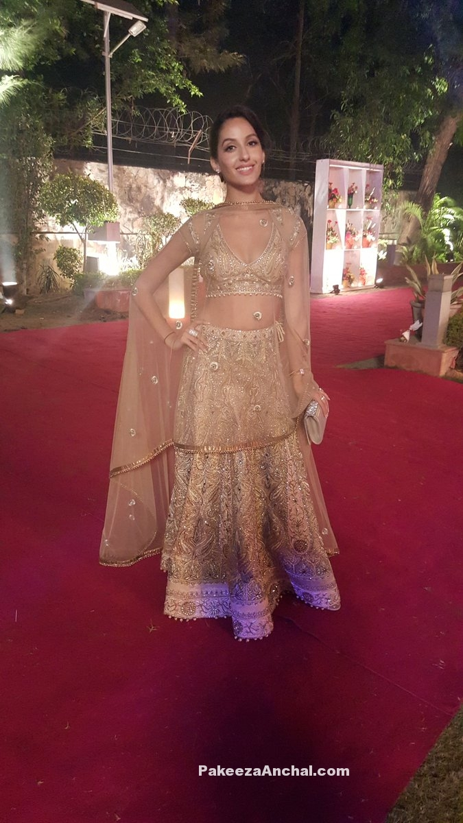 Nora Fatehi in JJ Valaya Golden Designer Lehenga on the red carpet-PakeezaAnchal.com