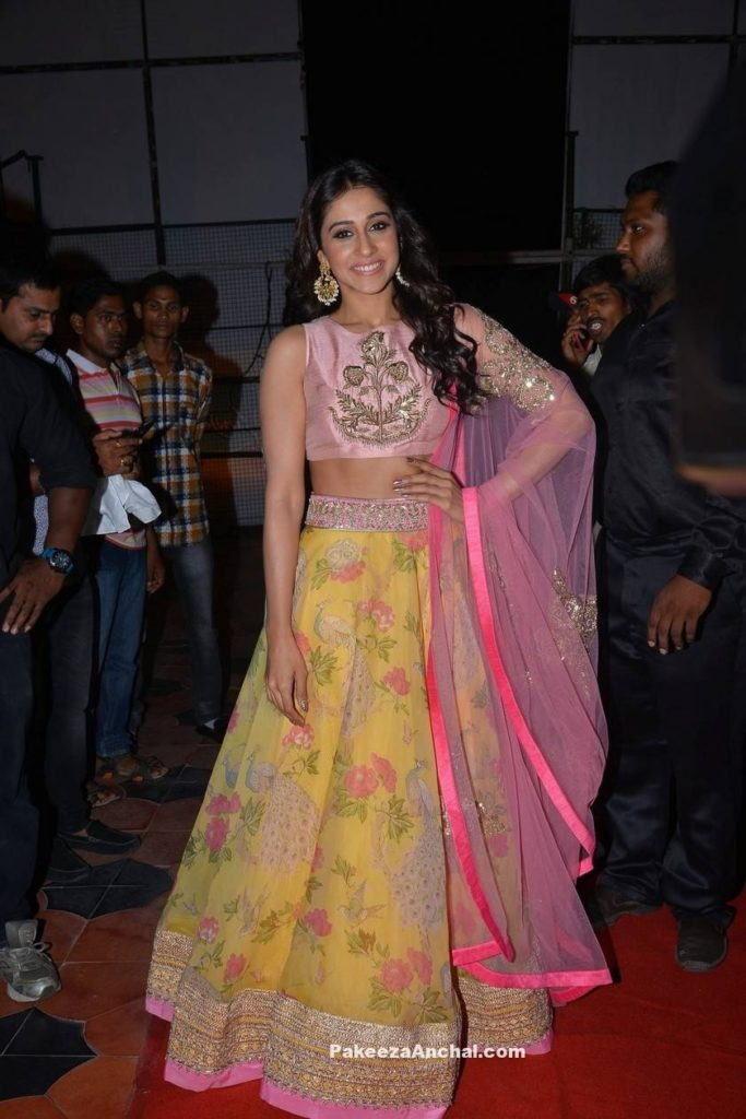 Regina Cassandra in Yellow floral Lehenga with Pink Embroidery High Neck net blouse PakeezaAnchal.com